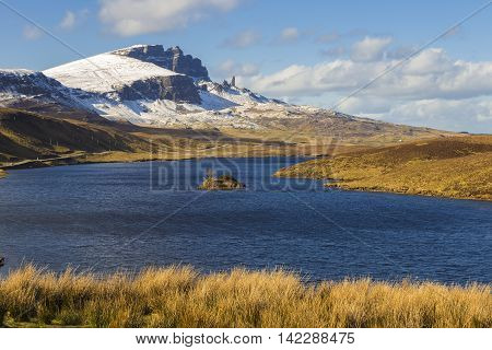 Loch Fada and the famous snowy Old Man of Storr on a sunny spring morning - Isle of Skye, Scotland, UK