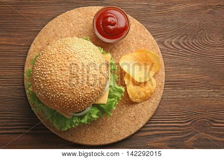 Fresh cheeseburger on wooden background