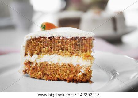Tasty slice of carrot cake on white plate