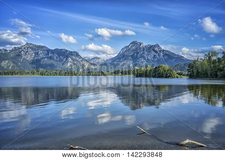An image of a view to Neuschwanstein at Forggensee lake