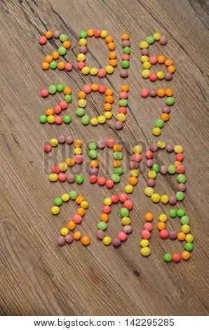 2016 2017 2018 2019 written with colorful candies on wooden background