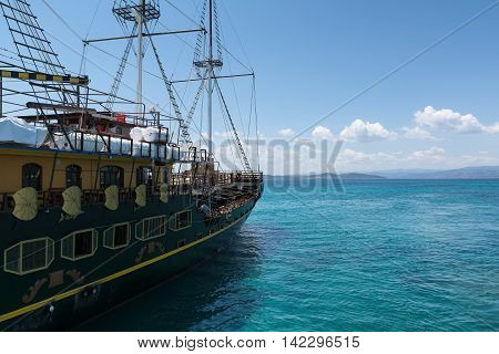 Sailing ship in the Aegean Sea on the background of mountains and hills of the Athos Peninsula Chalkidiki