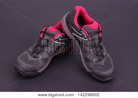 Women's hiking sport boots on black background