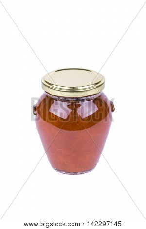 Apricot jam in a glass jar isolated on white background
