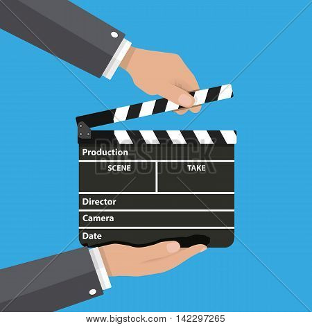 Black opened clapperboard in hands. Movie clapper board. vector illustration in flat style on blue background