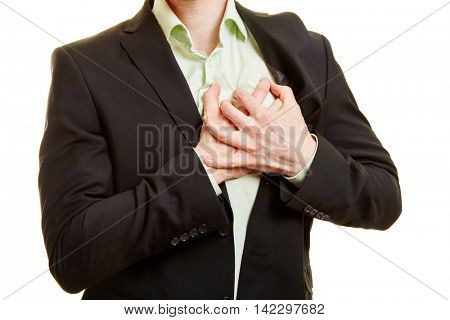 Man having a heart attack or a stroke with his hands on his chest
