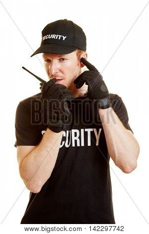 Segurity man alerts his team via radio with security clothes