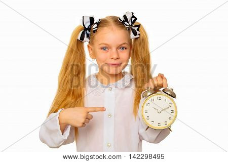 Pupil kid holding and pointing to alarm clock. Time management concept. Isolated on white background