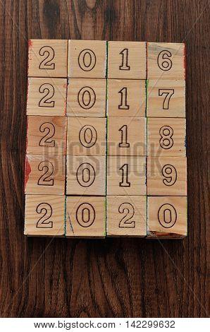 2016 2017 2018 2019 2020 written with wooden blocks on wooden