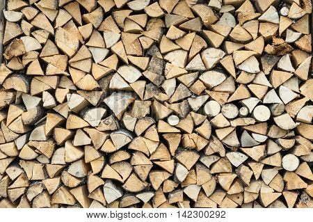 Pile of wood logs storage for industry close up