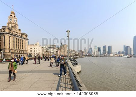 Shanghai, China: March 26, 2016: Tourists Walking In The Bund, The Most Scenic Spot In Shanghai. On