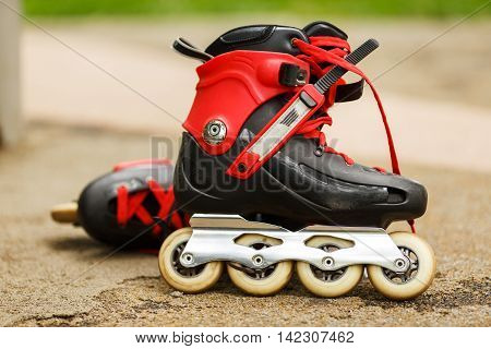 Inline skate close-up on nature background on road in park