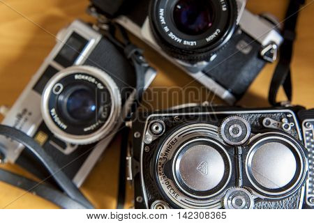 Madrid Spain - July 12 2016: Old film SLR and TLR camera over wooden background