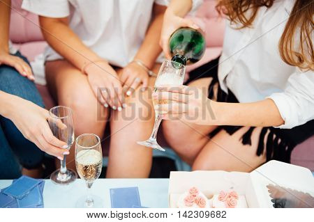 Guests At A Wedding Clink Glasses Of Champagne