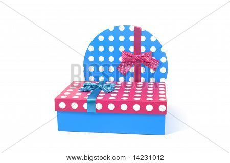 Two Present Decorated With Dots And Bows Isolated On White