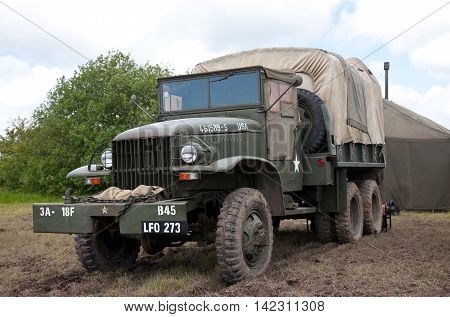 DENMEAD, UK - MAY 25: An ex US army Reo supply & service truck is parked at the side of the main arena at the Overlord show on May 25, 2014 in Denmead.