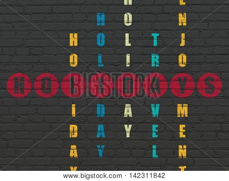 Holiday concept: Painted red word Holidays in solving Crossword Puzzle