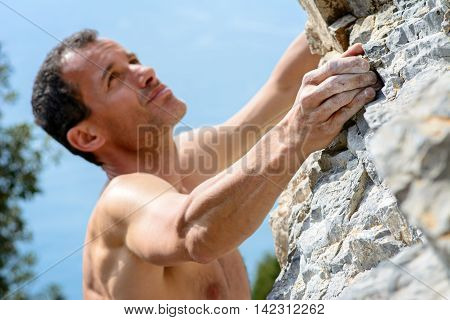 Man climbing on limestone. Muzzerone mountain, Liguria, Italy