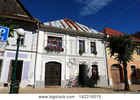 KEZMAROK SLOVAKIA - JULY 08 2016: The old historical building with entrance gate and two bicycles in Kezmarok town High Tatras Slovakia.