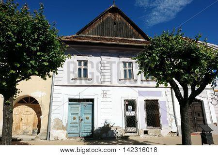 KEZMAROK SLOVAKIA - JULY 08 2016: The white historical building with blue entrance doors in Kezmarok town High Tatras Slovakia.