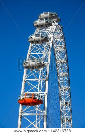 LONDON, UK - 20th NOVEMEBR 2013: Detail of the London Eye Millennium Wheel, showing closeup of the passenger cars, with clear blue sky background.