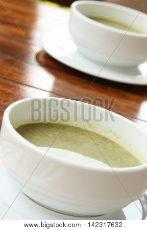 Two plates of hot soup on a summer terrace