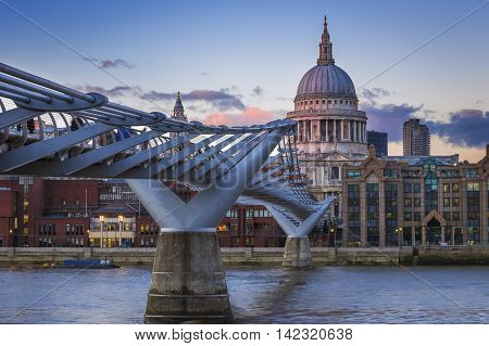 St.Paul's Cathedral with Millennium Bridge at sunset - London, UK