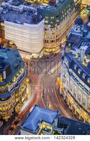 Aerial view of a busy street of central London at blue hour - England, UK