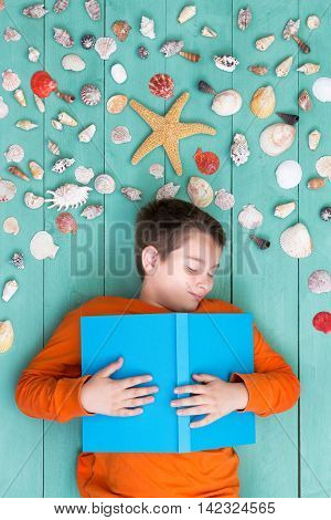 Young Boy Lying Dreaming Of A Summer Vacation