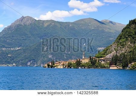 View Towards Lakeside Village Varenna At Lake Como With Mountains In Lombardy, Italy