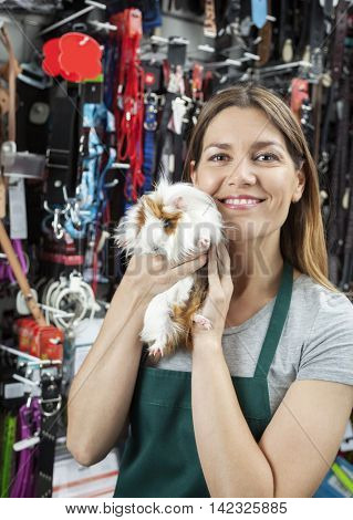 Saleswoman Holding Cute Guinea Pig At Store