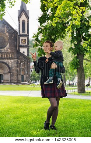 Happy Family Of Tourists On The Background Of Church Of St. Cyril And Methodius In The Karlin, Karli