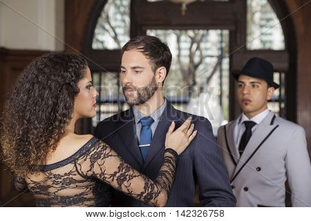 Man And Woman Performing Tango By Young Partner