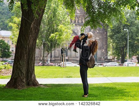 Family Of Tourists On The Background Of Church Of St. Cyril And Methodius In The Karlin, Karlinske N