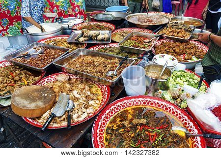 thai mixed street food stall vendor in bangkok thailand