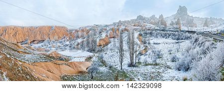 The red stone valley with the Uchisar citadel carved in rock located on the background Cappadocia Turkey.