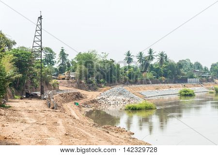 The construction site for built the protection dam near the river bend.