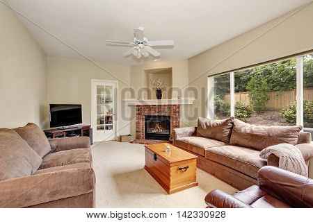 Cozy Elegant Family Room With Backyard View