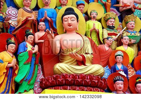 Mianyang China - October 15 2010: Buddha tableaux at the Sheng Shui Buddhist temple dating to the Tang and Qing Dynasties *