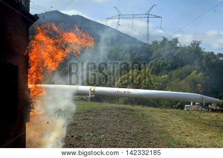 Volovets Ukraine - 7. October 2015: Conventional fire near a gas pipe in the Carpathians during a workout gas compressor station workers in emergency response.