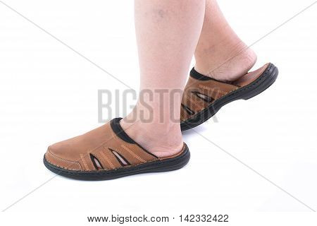 Close up of beautiful brown sandal made with real leather on white background isolated.