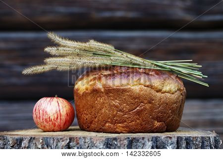 fragrant homemade bread with a ruddy crust on a wooden background