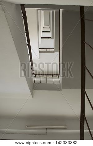 looking up stairwell building. Abstract architecture background.