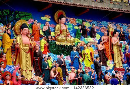 Mianyang China - October 15 2010: Hand-painted tableaux of Buddha's life extends across a wall at the Sheng Shui Buddhist Temple dating from the Tang and Qing Dynasties