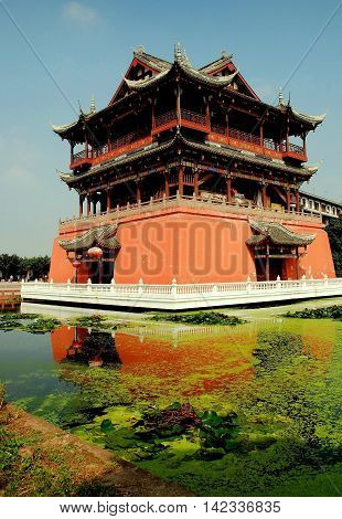 Luo Dai China - October 13 2007: Pavilion of the Five Phoenix with flying eave gabled roofs built on a square coral-coloured base surrounded by a moat
