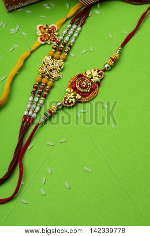 Indian festival: Raksha Bandhan background with Rakhi and Gift