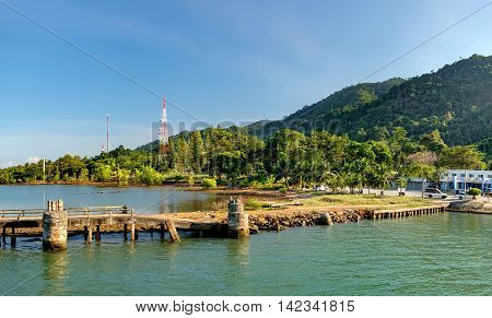 Port ferry boat in Koh Chang Island Thailand.Concrete ferry pier. Travel inspiration.