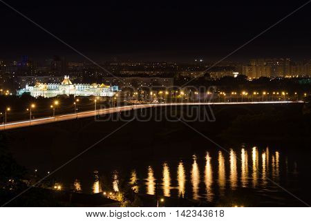 View of the city at night. Reflection in the river water