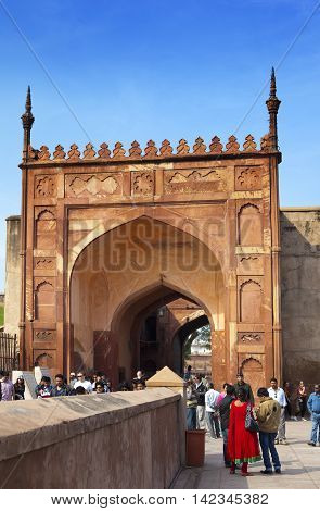 AGRA INDIA - JANUARY 28: A crowd of tourists visit Red Fort Agra on January 28 2014 in Agra Uttar Pradesh India. The fort is the old Mughal Empire capital and a UNESCO World Heritage Site.