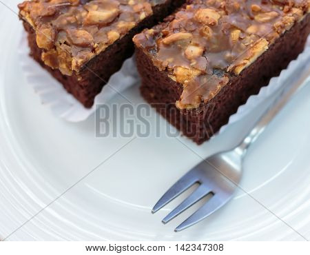Chocolate Brownies cake on the white plate.